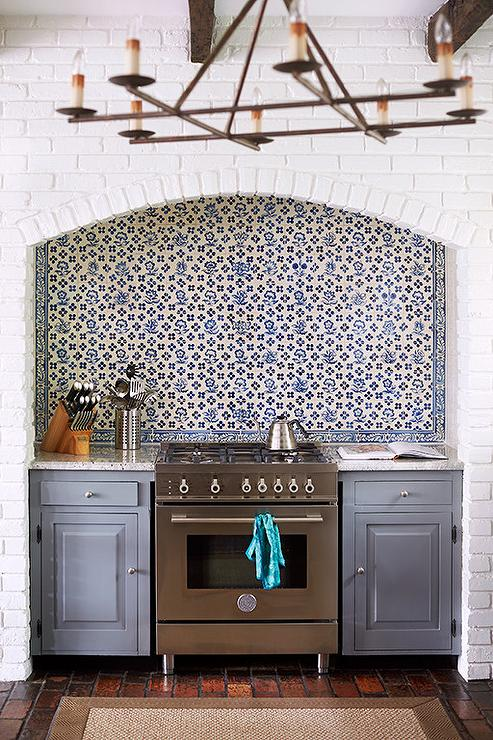 arched-cooking-alcove-nook-steel-gray-kitchen-cabinets-blue-mosaic-tiles
